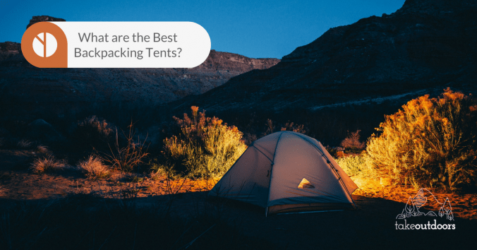 Picture of a tent infront of mountains at night
