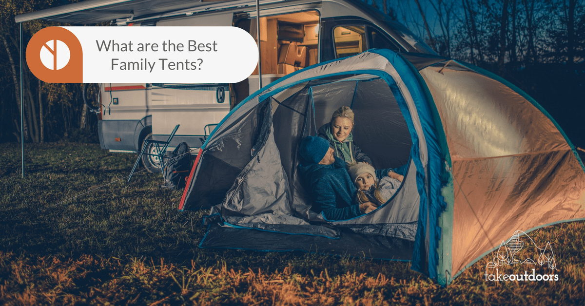 Picture of a tent with a family inside beside a campervan