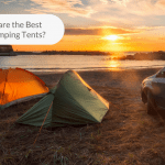 Photo of two tents and a car with a sunset view