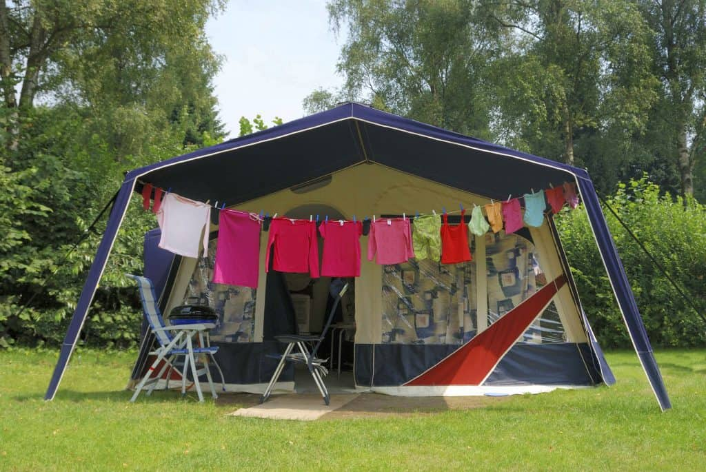 Photo of Tent at camping with cleaned and washed clothes in front