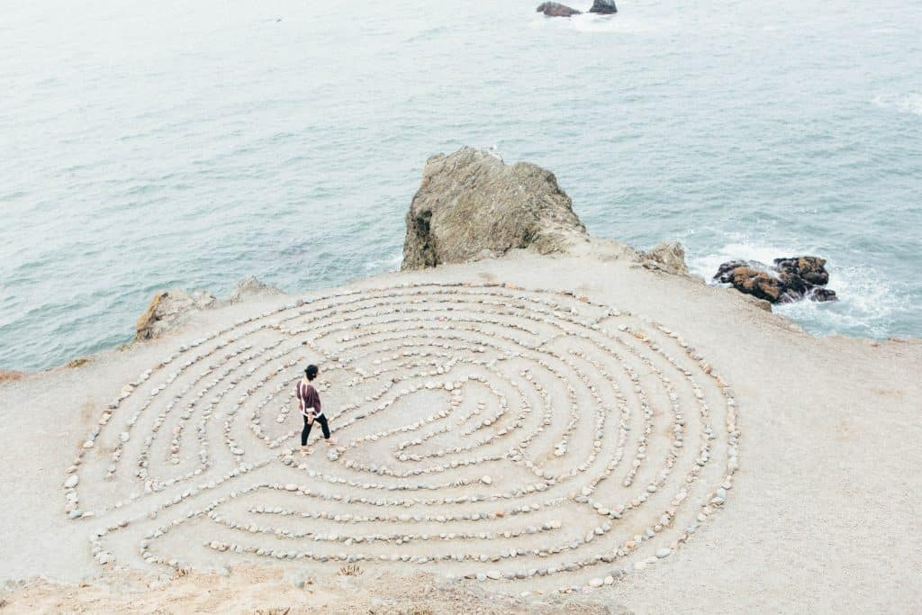 Picture of Young lady walk inside a circular formation similar to those in zen gardens