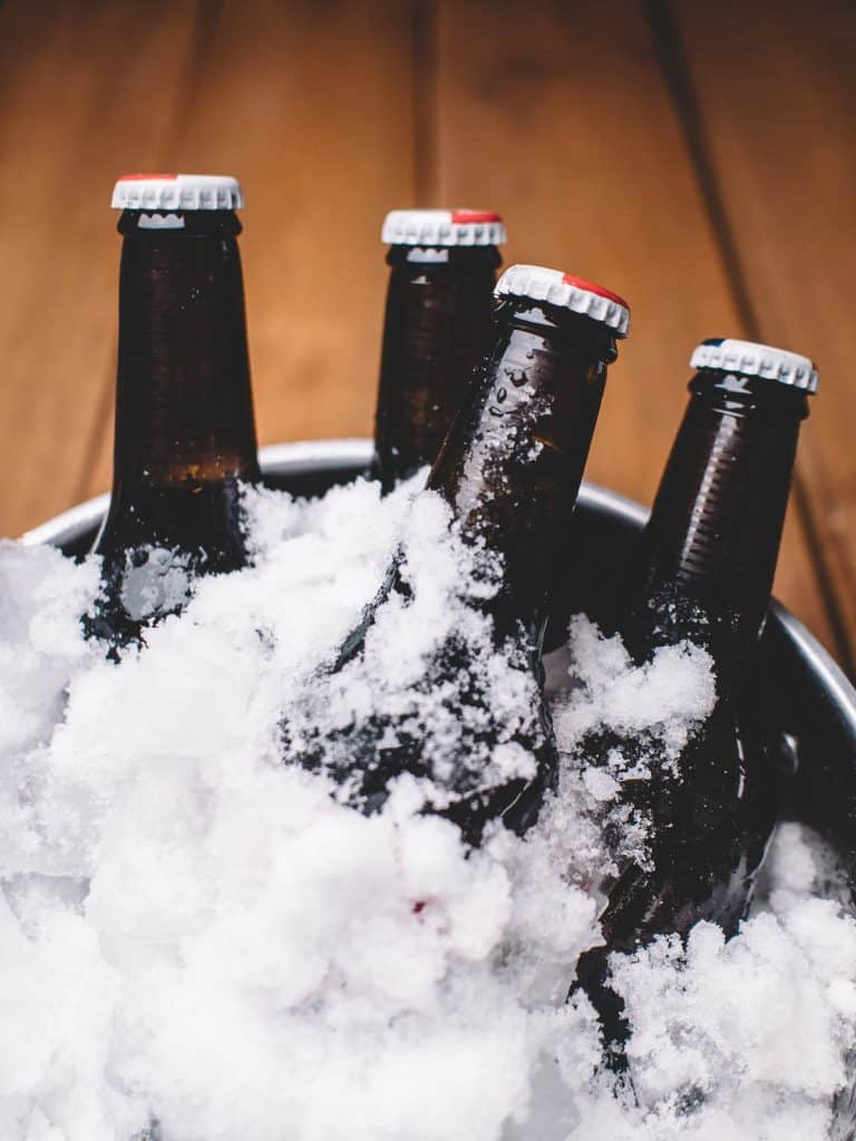 Picture of Beer Bottles in a bucket with snow ice