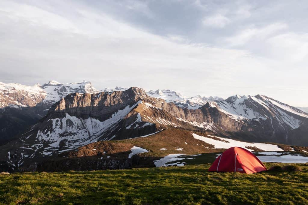 Tent infront of snowy mountain