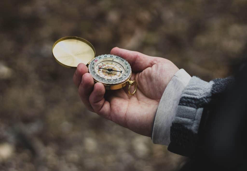 Man Holding A Compass