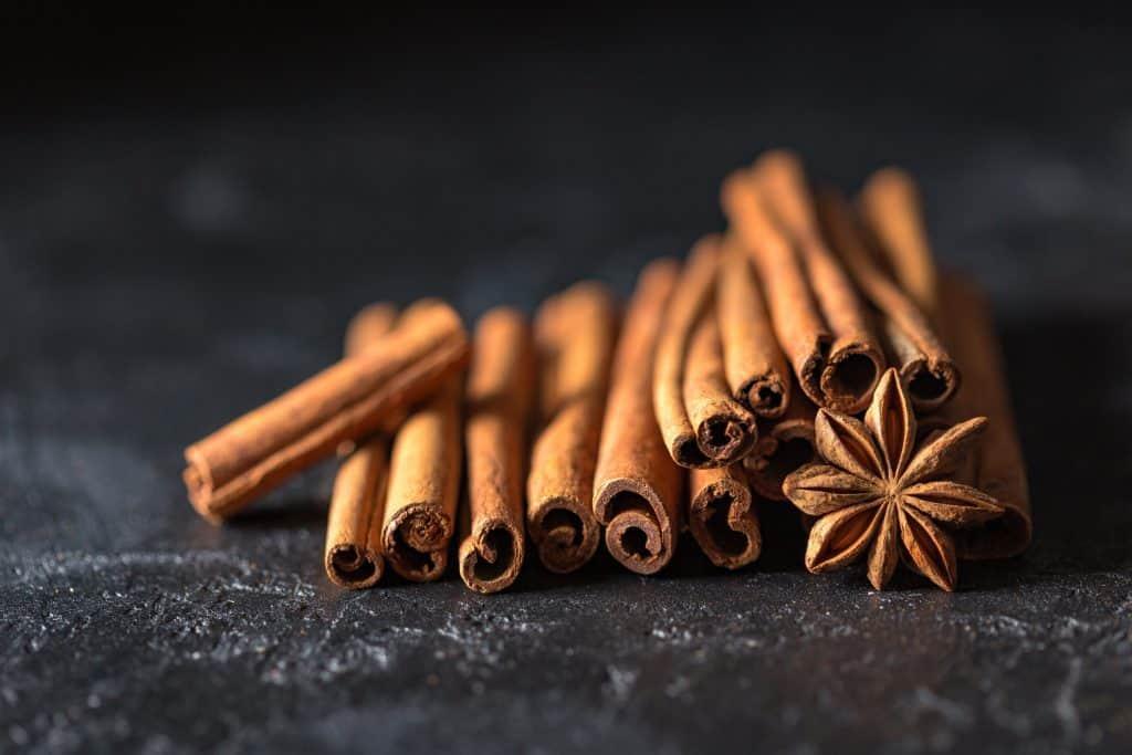 Cinnamon laid out on black ground