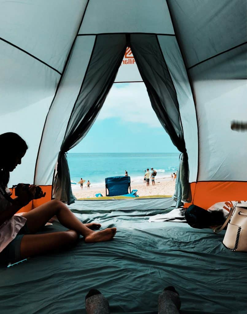 C&er engrossed in her phone in a tent & How to Stop Condensation in Tent - TakeOutdoors