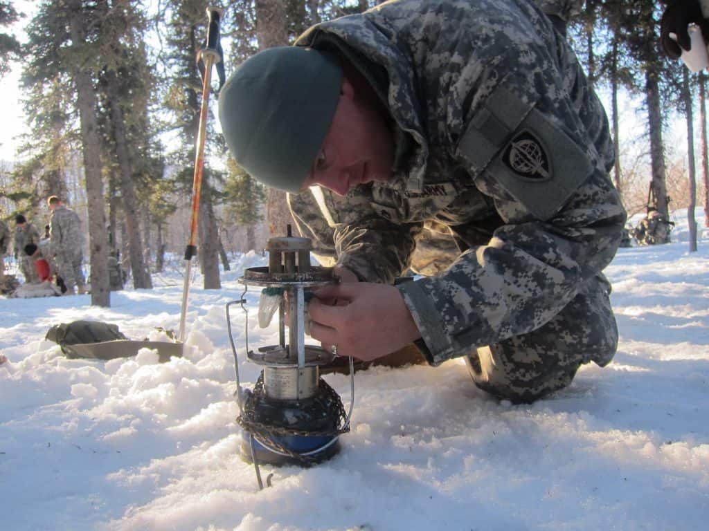 US Army Alaska Staff Sergeant installing Mantle on Coleman Lantern