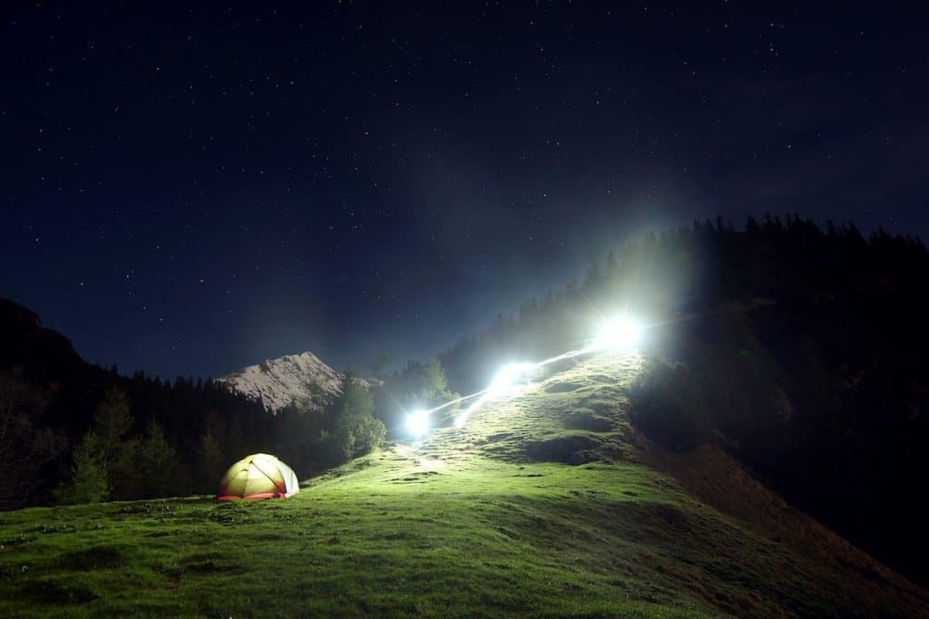 long shutter light photography beside tent