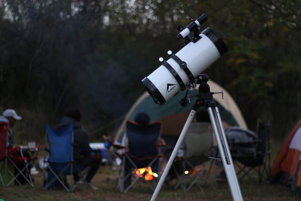 Looking for stars through telescope
