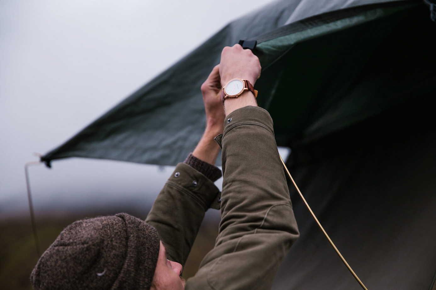 Man Setting Up Rainfly